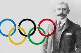 Pierre de Coubertin with the olympic rings